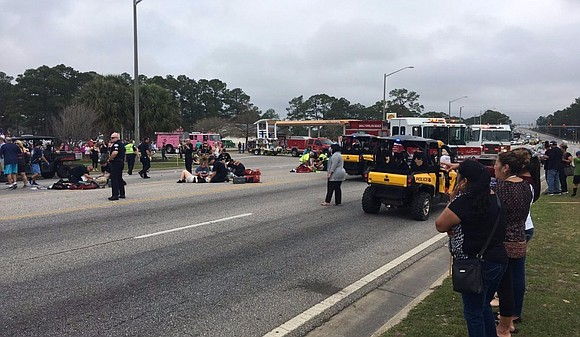 Twelve Alabama students were injured Tuesday when a car plowed into a marching band during a Mardi Gras parade