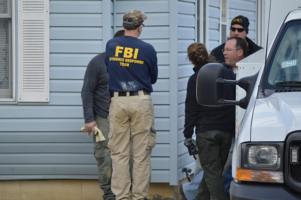 State Police and FBI crime scene technicians continue the excavation on the basement of home on Margaret Street in Joliet in connection to a 1990 disappearance.