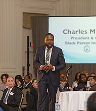 """Charles McGee, president and chief executive officer of Portland's Black Parents Initiative, addresses the non-profit group's """"Circle of Growth"""" benefit on Feb. 22 at the Sentinel Hotel, downtown. The luncheon drew hundreds of supporters and raised more than $146,000 for programs to help parents make healthy choices in a child's life and help educate and mobilize families to achieve success."""