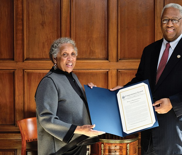 Richmond Free Press Publisher Jean P. Boone receives a citation from 4th District Congressman A. Donald McEachin — a copy of his remarks placed in the Congressional Record commemorating the newspaper's 25th anniversary. 