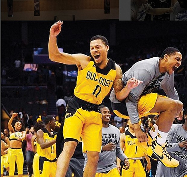 The Bowie State Bulldogs celebrate their 62-54 championship victory over Fayetteville State University last Saturday.