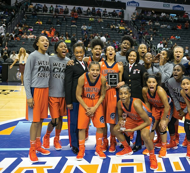 The Virginia State University women's basketball team celebrates last Friday after making it to the CIAA finals
