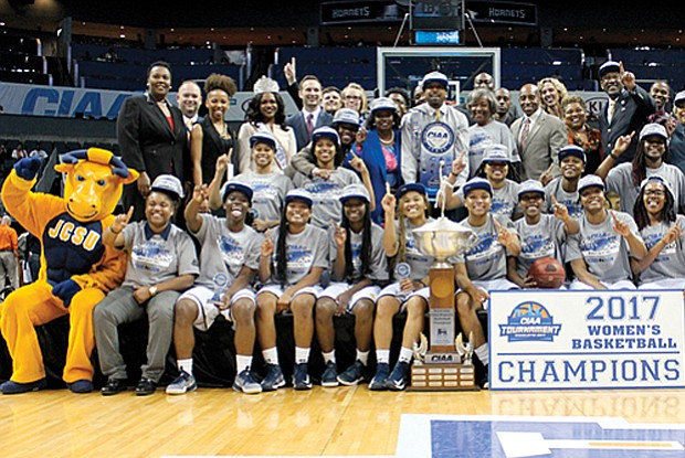 The Johnson C. Smith Golden Bulls women's team celebrates its tournament title and 68-59 victory over the Virginia State University women's team.