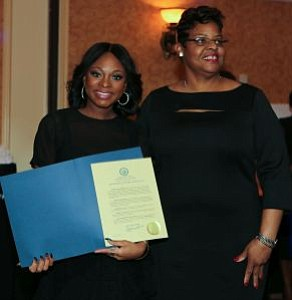 Naturi Naughton receives a proclamation from a member of the Office of the Mayor and Lawnside Borough Council. -- Photo by April A. Ward