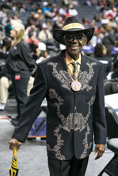 "Mr. CIAA, Abraham ""Ham"" Mitchell of Suffolk, sports one of his custom outfits around the arena in Charlotte. The colors are those of the Bowie State Bulldogs."