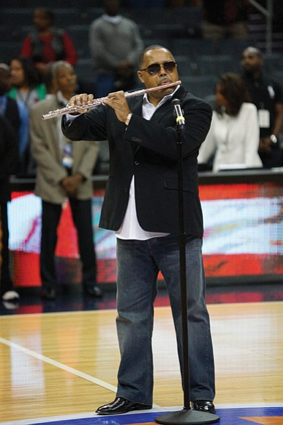 Jazz artist Najee performs the national anthem before last Saturday's championship game.