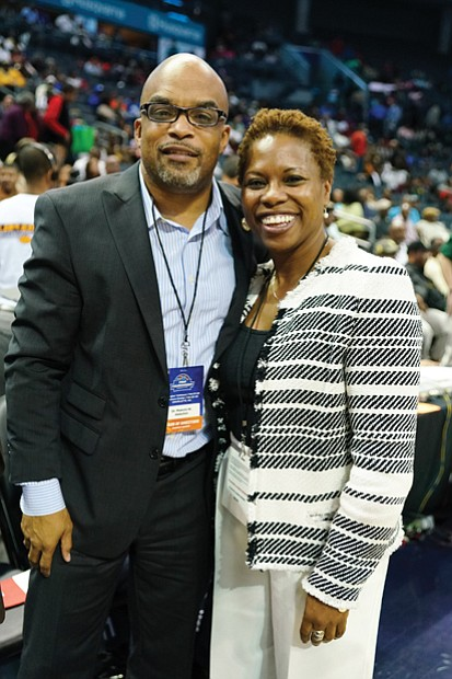 "Virginia State University President Makola M. Abdullah stops for a photo with CIAA Commissioner Jacqueline ""Jacqie"" McWilliams."