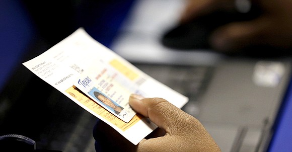The Trump administration plans to abandon the federal government's longstanding opposition to a key portion of Texas' toughest-in-the-nation voter ID ...