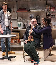 "(l-r) Alejandro Simoes as Oscar, Thomas Derrah as Frog and Melinda Lopez as Shelley in a scene from the SpeakEasy Stage Company production of ""Grand Concourse."""