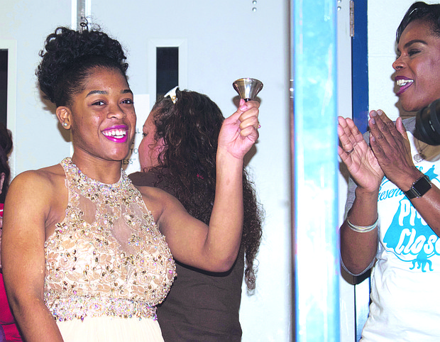 Bryana Terrell rings the bell, signaling that she has selected the dress for her prom night.