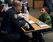 Memphis Police Department Director Michael Rallings talks with an elementary school student who told him that he wants to be a policeman. (Photo: Karanja A. Ajanaku)