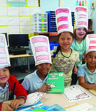 "Farring Elementary School students make their own ""Cat In the Hat"" attire during National Reading Day with United Way of Central Maryland volunteers"
