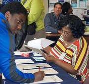 Memphis residents sign up for three-minute exchanges with local public officials at the Whitehaven Library. (Photo: Karanja A. Ajanaku)