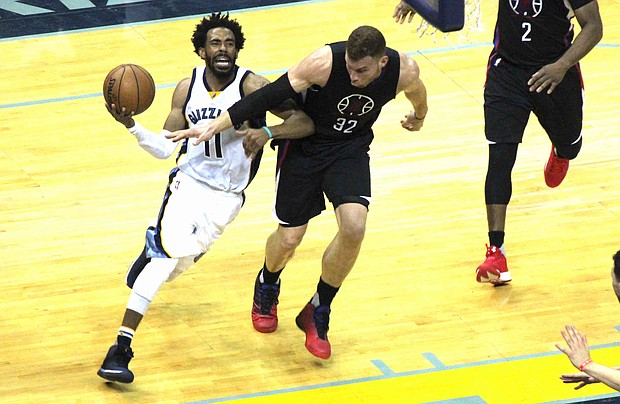 Mike Conley drives to the basket on Clippers Forward Blake Griffin. Conley was held to 12 points on 3-14 shooting for the game, which the Grizzlies lost 114-98.