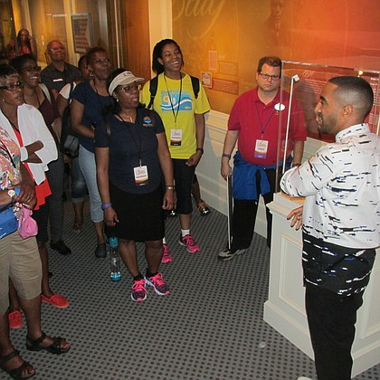 Khalil Kinsey gives a tour of the Kinsey Collection at the Disney Dreamers Academy