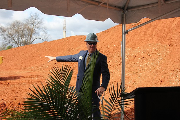 Avondale Estates Mayor Elmore points where the groundbreaking of the four-floor, mix-use development is located.