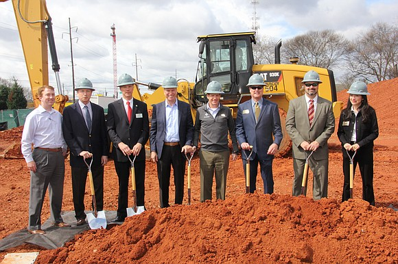Avondale Estates mayor and business leaders celebrate groundbreaking of mixed-use development.
