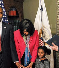 Dr. Ben Carson (left) was sworn in as the Secretary of Housing and Urban Development on Thursday, March 2. Carson's wife along with his 5-year-old granddaughter, Tesora held the Bible. (Shevry Lassiter/The Washington Informer).