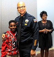 MPD Director Michael Rallings links up with one of the boys in attendance for the grand opening of the youth-focused Police Activities League. (Courtesy photos)
