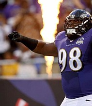 Baltimore Ravens defensive tackle Brandon Williams plays to the crowd as he is introduced during the pre-game ceremonies before a game in 2016.