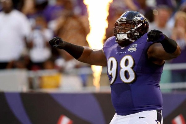 Baltimore Ravens defensive tackle Brandon Williams plays to the crowd as he is