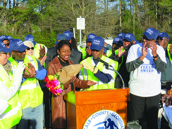 Cynthia Houston, who has been picking up trash in her Stone Mountain neighborhood for more than 16 years, got roses ...