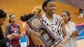 Virginia Union University's Lady Walker poses with the victory trophy and net Monday night after the Lady Panthers defeated California University of Pennsylvania to win the NCAA Division II Atlantic Region title. Lady Walker scored 32 points in the regional championship game and was named to the All-Atlantic Region team.