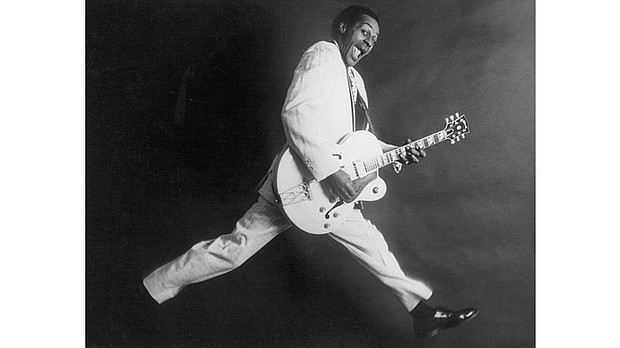 Rock and roll musician Chuck Berry poses for a portrait holding his Gibson hollowbody electric guitar in circa 1958. (Michael Ochs Archives/Getty Images via The Undefeated)