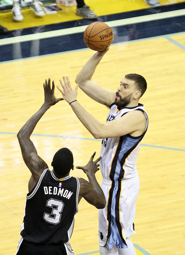 Marc Gasol takes a baby-hook over the San Antonio Spurs.