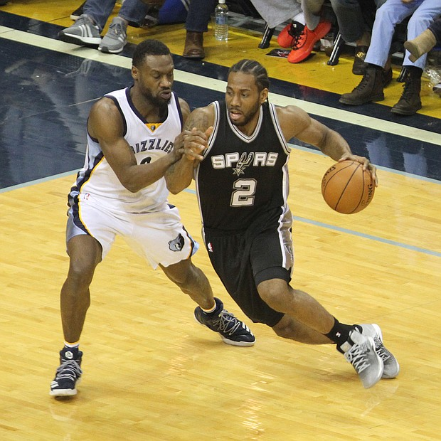 Spurs Forward Kawhi Leonard attempts to drive on Grizzlies Guard Tony Allen during a March 18 matchup at FedExForum. The Grizzlies turned up their defense and used a fourth-quarter burst to take the win, 104-96.