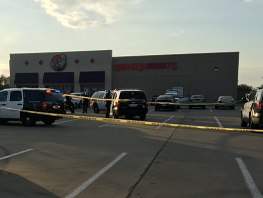 Two children were shot accidentally outside the Chuck E. Cheese's on Southwest Loop 820 near Hulen Mall.