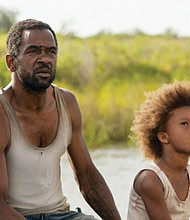 Dwight Henry as 'Wink' and Quvenzhane Wallis as 'Hushpuppy' in Beasts of the Southern Wild.