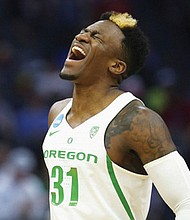 Oregon guard Dylan Ennis celebrates in route to a second round NCAA tournament win against Rhode Island Sunday in Sacramento, Calif. The Ducks face Michigan on Thursday.