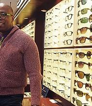 Entrepreneur and musician Bobin Nicholson in Eye & Eye Optics, the Lower Mills eyewear boutique he has owned since 2010.