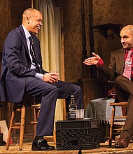"""Tyrone Mitchell Henderson and Matthew J. Harris in the Huntington Theatre Company's production of """"Topdog/Underdog."""""""