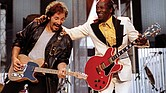 "Chuck Berry, right, performs his highly popular tune ""Johnny B. Goode"" with Bruce Springsteen to open The Concert for the Rock & Roll Hall of Fame in September 1995 at Cleveland Stadium."