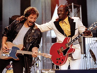 """Chuck Berry, right, performs his highly popular tune """"Johnny B. Goode"""" with Bruce Springsteen to open The Concert for the Rock & Roll Hall of Fame in September 1995 at Cleveland Stadium."""