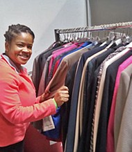 "Private First Class Selena Johnson, Active Guard Reserve,in the process of selecting a new suit at the ""Marching Our Veterans Back to Work"" event held in Glen Burnie earlier this month."