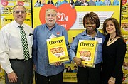 ShopRite of Lawnside owners David and Renee Zallie join Lou Salerno and Cora Williams. - SUBMITTED PHOTO