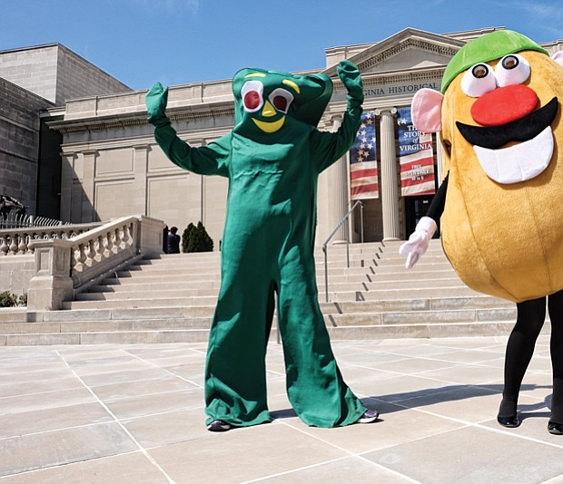 """Gumby"" and ""Mr. Potato Head"" strike a pose in front of the Virginia Historical Society on North Boulevard Wednesday as they prepared to take part in a promotional video for the society's ""Toys of the '50s, '60s and '70s"" exhibition. Visitors can see popular toys from those decades, learn about their inventors and hear the memories of people who played with the games through the exhibit that runs through Labor Day. Olivia Lukanuski is inside the Gumby suit, while Jennifer Nesossis is the lively Mr. Potato Head."