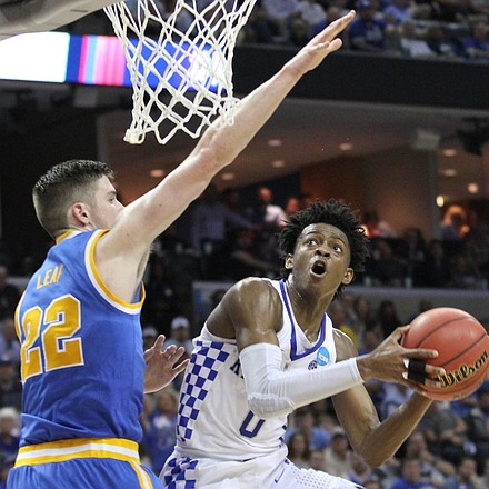 De'Aaron drives to the basket and scores on TJ Leaf of UCLA.