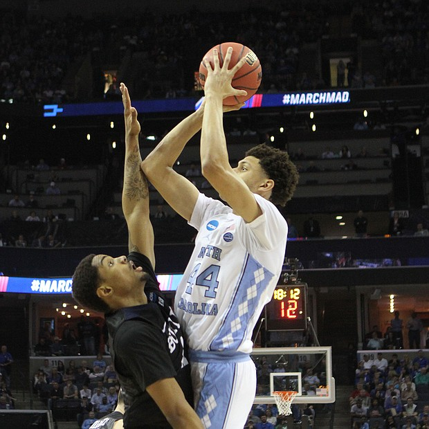 Justin Jackson of North Carolina (right) shoots and scores over Kethan Savage. North Carolina defeated Butler 92-80.