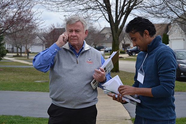Mayor Roger Claar (left) out canvassing with volunteer Ravish Patel (right).