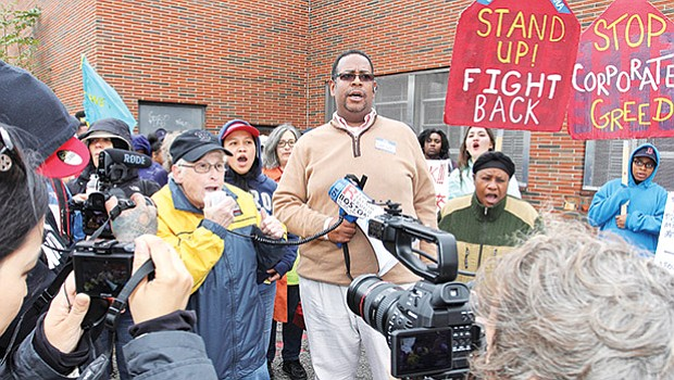 Darnell Johnson (center) holds a bullhorn during an affordable housing demonstration in Dorchester last year. Johnson heads the Right to the City Coalition, a group of organizations working on preserving affordability in Boston's housing market.
