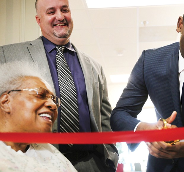 Richmond Mayor Levar M. Stoney cuts the ribbon celebrating the completion of the $5 million renovation of the William Byrd Senior Apartments, a former hotel at 2501 W. Broad St. that now provides 104 rental units for the elderly and disabled.