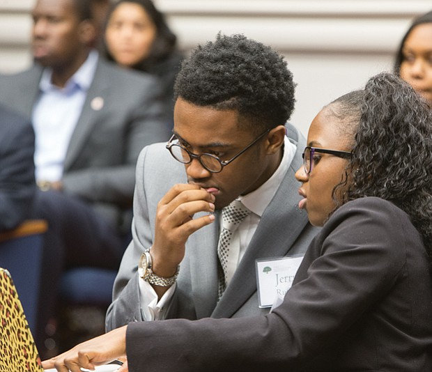 "The Great Debaters // Jerry Ruffin and Riqia Taylor strategize before presenting their argument during ""The Great Debate"" sponsored by The Gloucester Institute Board of Directors and its president, Kay Coles James. Teams of college students who are part of the institute's Emerging Leaders program debated the question of immigration over two days."
