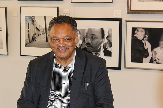 Rev. Jesse Jackson looked back at the images of Dr. Ernest Withers during a Monday afternoon visit to the Withers Gallery on Beale St.