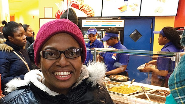 Cecile Grossett of Dorchester, a frequent Golden Krust customer, enjoyed the grand opening festivities April 1.