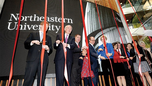 Elected officials join Northeastern University President Joseph Aoun (second from right) for the ribbon-cutting ceremony celebrating the opening of Northeastern University's Interdisciplinary Science and Engineering Complex on Columbus Avenue.