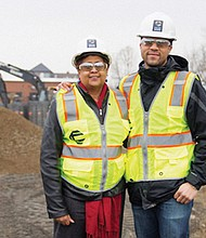 Portland Development Commission Project Manager Kim Moreland and Alex Colas of Colas Construction oversee the construction of Alberta Commons, the future site for a Natural Grocers store and a strip of small, minority-owned businesses at Northeast Alberta and Martin Luther King Jr. Boulevard.